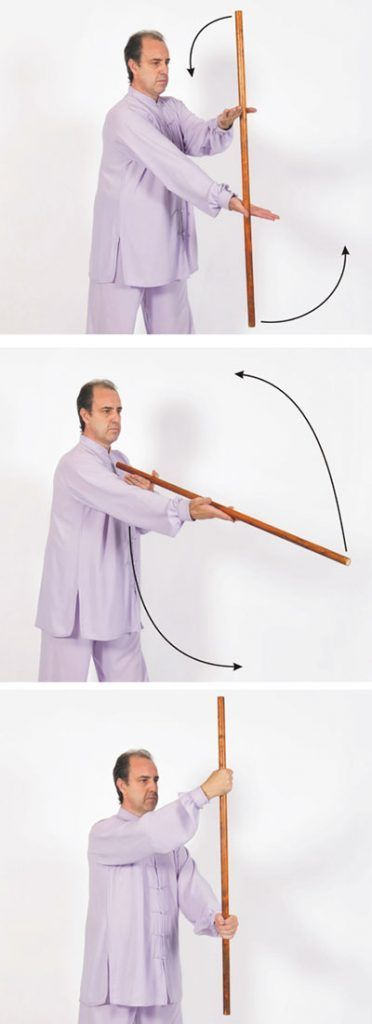 Taiji Yangsheng Zhang invertir el bastón.